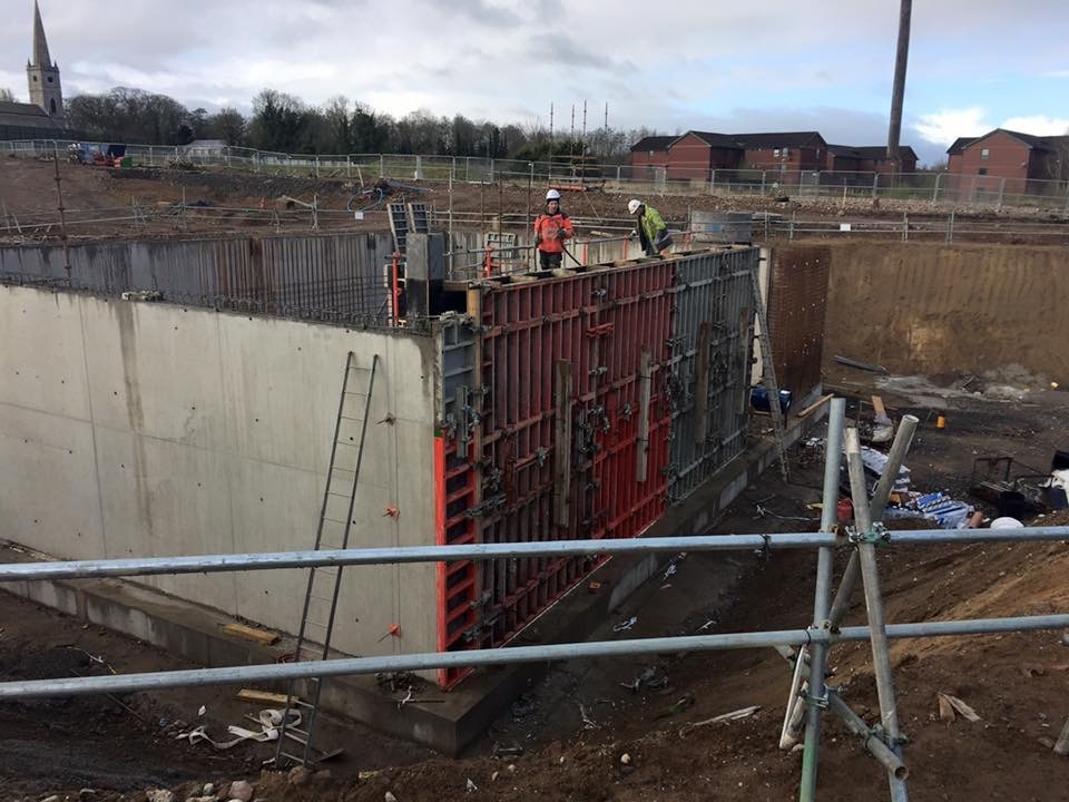 Reinforced concrete walls being constructed