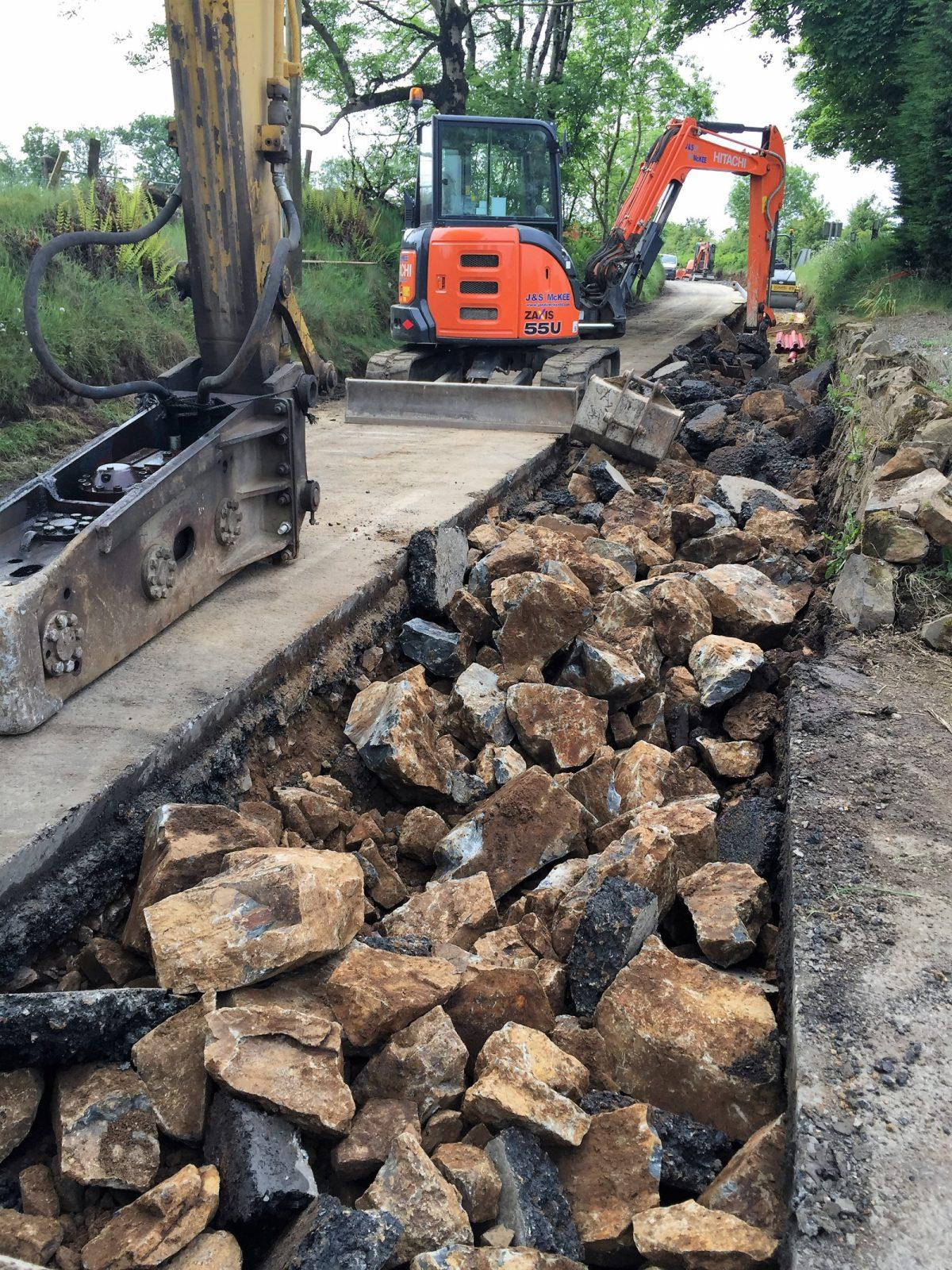 Breaking roadway for cable laying